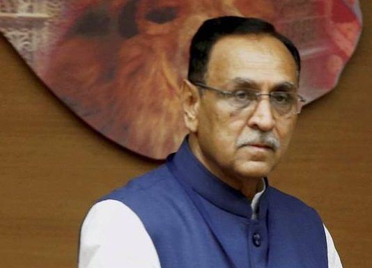 Rupani files nomination papers, targets Congress