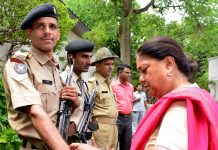 Chief Minister, Vasundhara Raje, holds, commandos, Rakhi